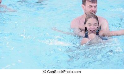 Happy family enjoying in pool
