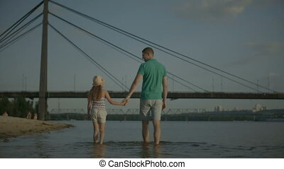 Happy family enjoying weekend on riverbank - Joyful relaxed...