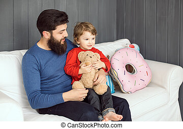 Happy family. Father and son playing together