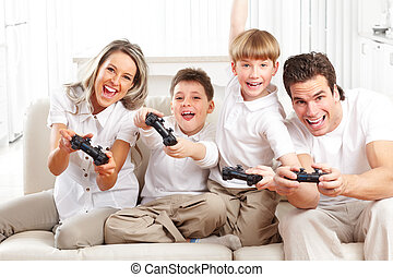 Happy family. Father, mother and children playing a video...