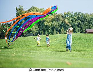 Happy family flying kite