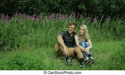 happy family four sitting on grass summer day