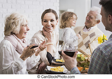 Happy multi-generational family gathering during holidays at the table