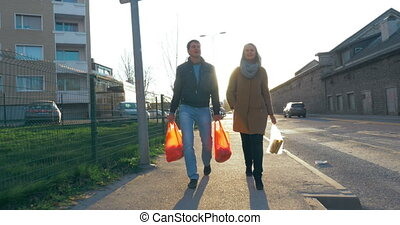 Happy Family Going Home With Grocery Bags - Steadicam shot...