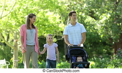 Happy family going on a walk in the park