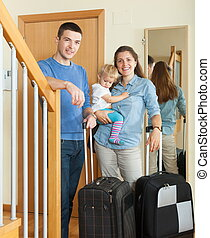 Happy family going on holiday - Happy family of three with...