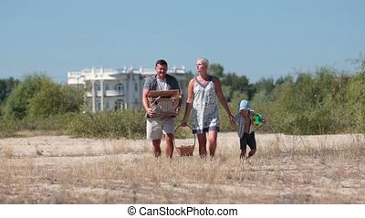 Happy family going on pinic to the beach