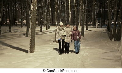 Family walk in a winter park