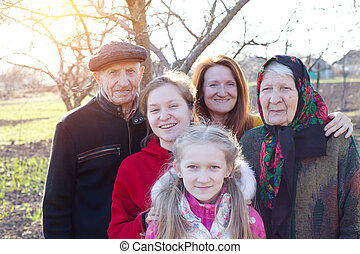 happy family - grandfather, grandmother, granddaughter and daughter