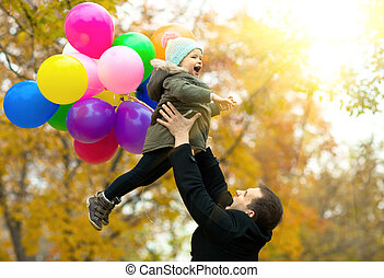 happy family - happy father toss up little child with air-...