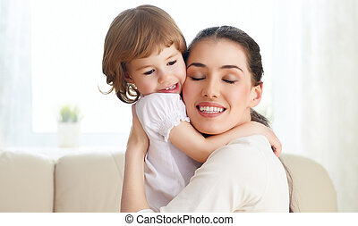 happy family - happy mother holding her child