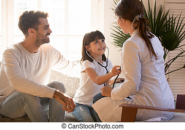 Happy family have fun playing doctor game together
