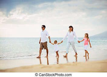 Happy Family have Fun Walking on Beach at Sunset
