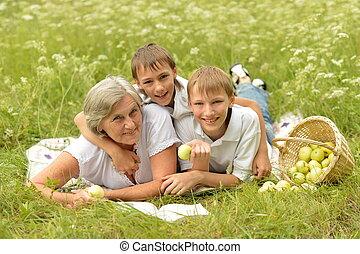 Happy family having a picnic on a sunny day
