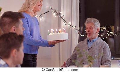 happy family having birthday party at home - celebration and...