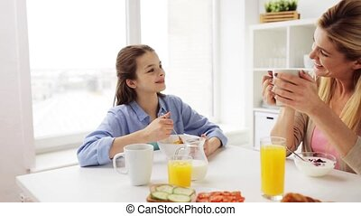 happy family having breakfast at home kitchen