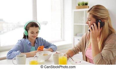 happy family having breakfast at home kitchen - food,...