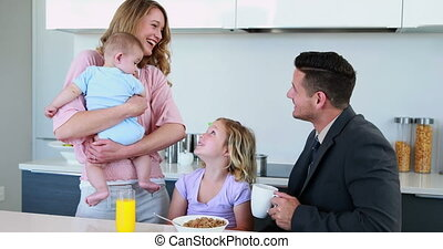 Happy family having breakfast toget