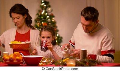 happy family having christmas dinner at home