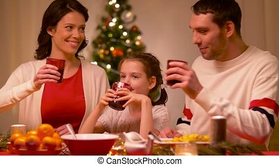happy family having christmas dinner at home - holidays,...