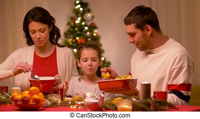 happy family having christmas dinner at home