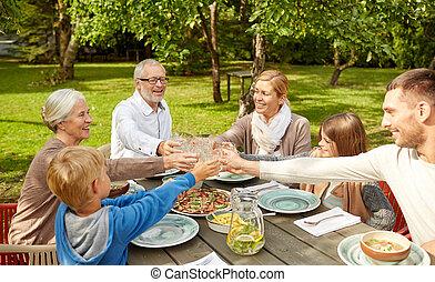 happy family having dinner in summer garden - family,...