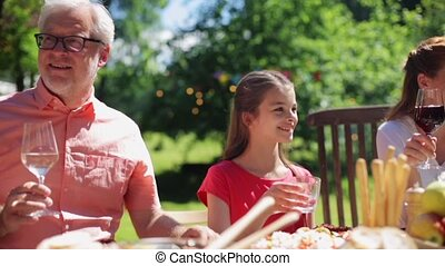 happy family having dinner or summer garden party - leisure,...
