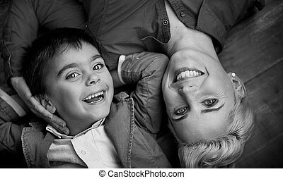 Happy family having fun - Black-white photo of posing mother...
