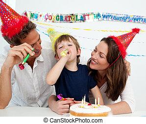 Happy family having fun during a birthday