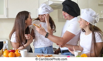 Happy Family Having Fun Eating Pizza.