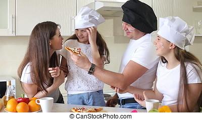 Happy Family Having Fun Eating Pizza.