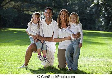 Happy Family Having Fun In A Park