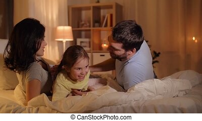 happy family having fun in bed at home