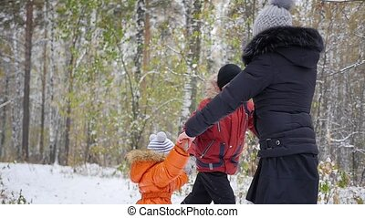 happy family having fun in winter Park