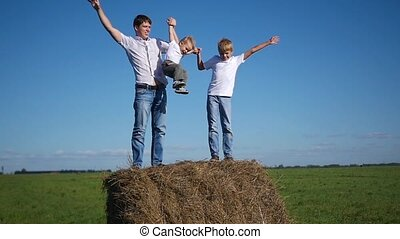 happy family having fun on haystack