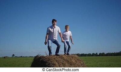 happy family having fun on haystack