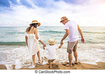 Happy family  Having Fun Playing on the Beach