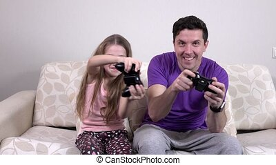 Happy family having fun playing video console games together