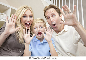 Happy Family Having Fun Sitting Laughing At Home