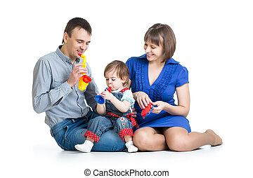 Happy family having fun with musical toys. Isolated on white background