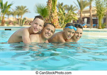 Happy family having in pool