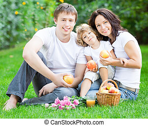 Happy family having picnic