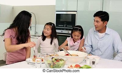 Happy family having spaghetti dinne