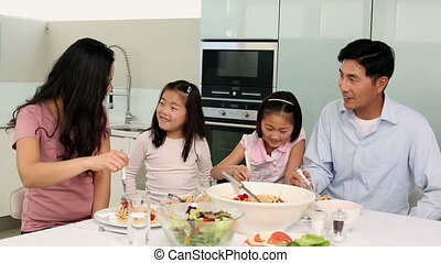 Happy family having spaghetti dinner together at home in the...