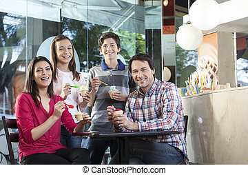 Happy Family Having Various Ice Creams In Parlor