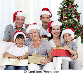 Happy family holding Christmas presents