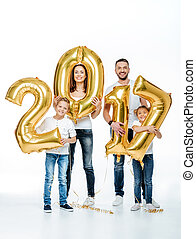 Happy family holding golden balloons