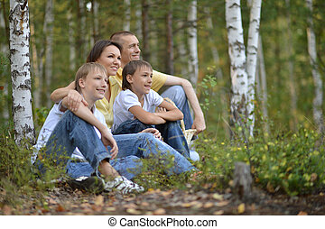 Happy family in a birch forest
