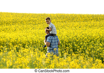 happy family in a field of yellow flowers