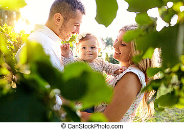 Happy family in a park in summer.